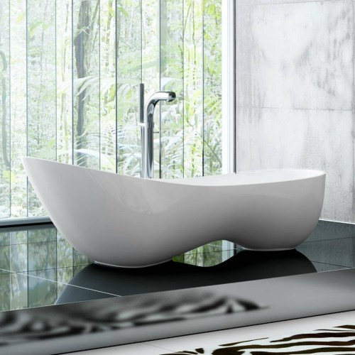 Victoria + Albert Cabrits bath in volcanic limestone is distributed in Quenesland by Luxe by Design, Brisbane.