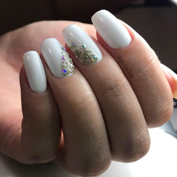 White manicure with design