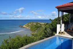 Infinity pool and view from Villa at Scrub Island