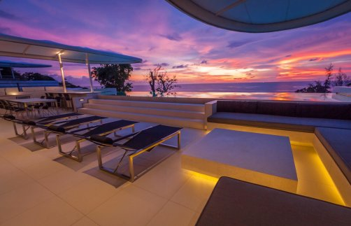 LuxeGetaways - Luxury Travel - Luxury Travel Magazine - Luxe Getaways - Luxury Lifestyle - Luxury Villa Rentals - Affluent Travel - Kata Rocks Phuket Thailand - beautiful sky and pool