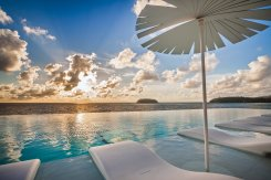 LuxeGetaways - Luxury Travel - Luxury Travel Magazine - Luxe Getaways - Luxury Lifestyle - Luxury Villa Rentals - Affluent Travel - Kata Rocks Phuket Thailand - Pools and lounge chairs at sunset
