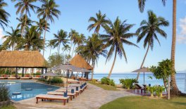 LuxeGetaways - Luxury Travel - Luxury Travel Magazine - Romantic Travel Getaways - Fiji - Fiji Resort - pool lounge - palm trees