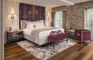LuxeGetaways - Luxury Travel - Luxury Travel Magazine - Luxe Getaways - Luxury Lifestyle - The Ivey's Hotel Charlotte - North Carolina - Iveys Hotel - Bedroom - Brick Wall - Historic floors