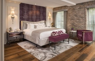 LuxeGetaways - Luxury Travel - Luxury Travel Magazine - Luxe Getaways - Luxury Lifestyle - The Ivey's Hotel Charlotte - North Carolina - Iveys Hotel - Bedroom - Brick Wall - Historic floors