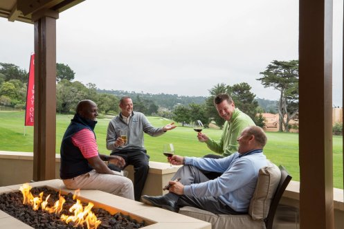 LuxeGetaways - Luxury Travel - Luxury Travel Magazine - Luxe Getaways - Luxury Lifestyle - Pebble Beach Resorts - Fairway One - California - Luxury Golf Resort - friends drinking wine on patio of cottage