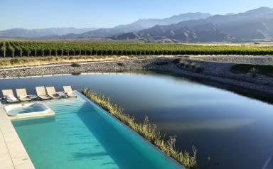 LuxeGetaways - 25 Poolside Experiences - Luxury Hotel Pools - Casa De Uco