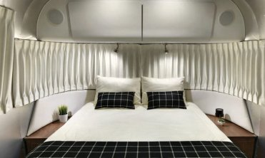 LuxeGetaways - Luxury Travel - Luxury Travel Magazine - Luxe Getaways - Luxury Lifestyle - Airstream Globetrotter - luxury travel trailer - 100K Trailer - Glamping