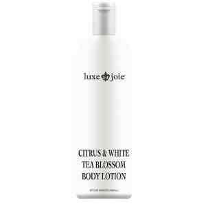 citrus and white tea blossom body lotion on white background
