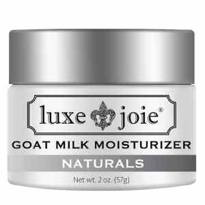 goat milk moisturizer on white background