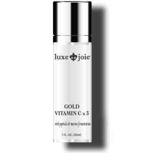 gold vitamin c x 3 facial serum on white background