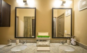 Bathroom Mirror at The Southwestern Apartments in Uptown Dallas TX Lux Locators Dallas Apartment Locators