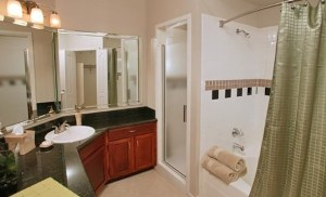 Bathroom Shower at Riviera at West Villiage Apartments in Uptown Dallas TX Lux Locators Dallas Apartment Locators