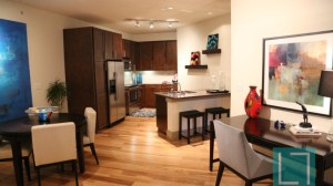 Living Room Kitchen at The Monterey by Windsor Apartments in Uptown Dallas TX Lux Locators Dallas Apartment Locators