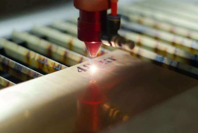 stage of manufacturing, laser engraving in automatic mode, close-up, blurred background