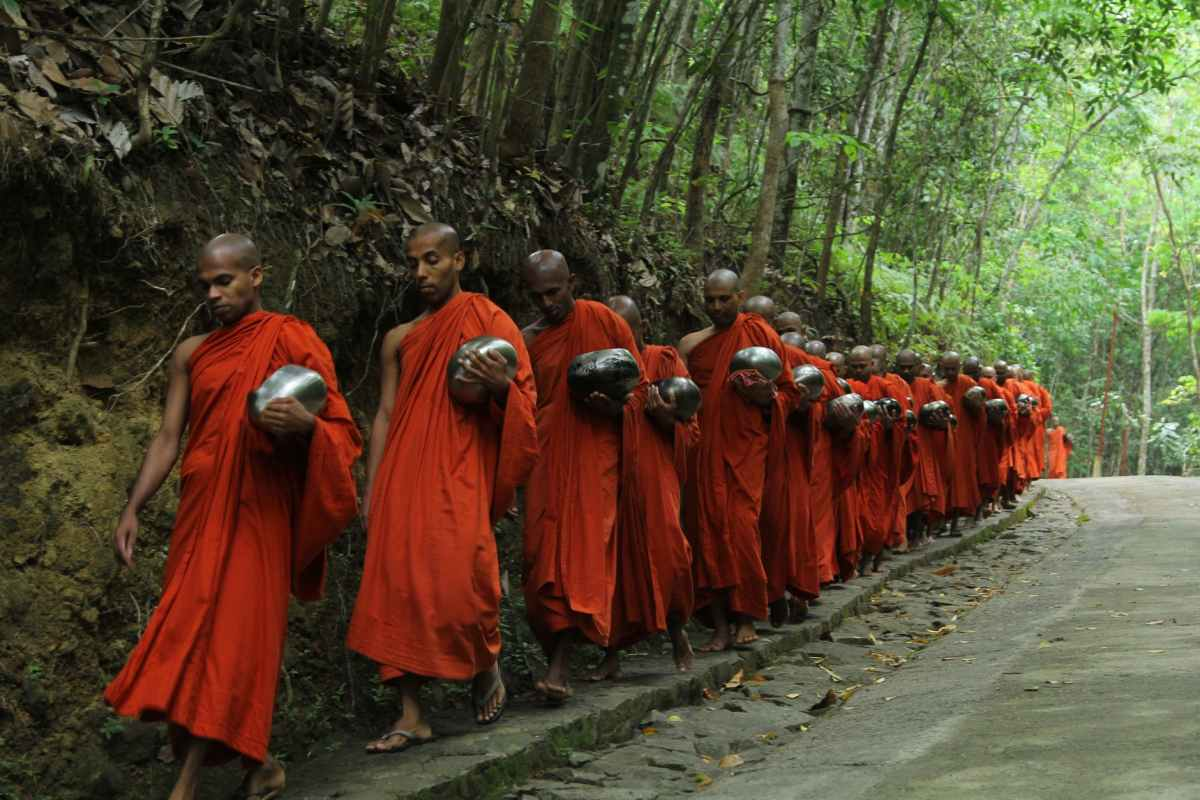 monks fall inline on sidewalk