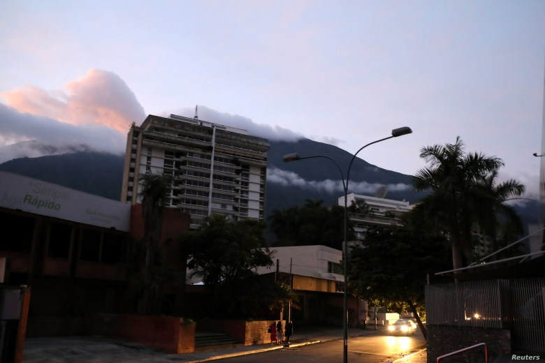 People walk on the street during a blackout in Caracas, Venezuela, July 22, 2019.