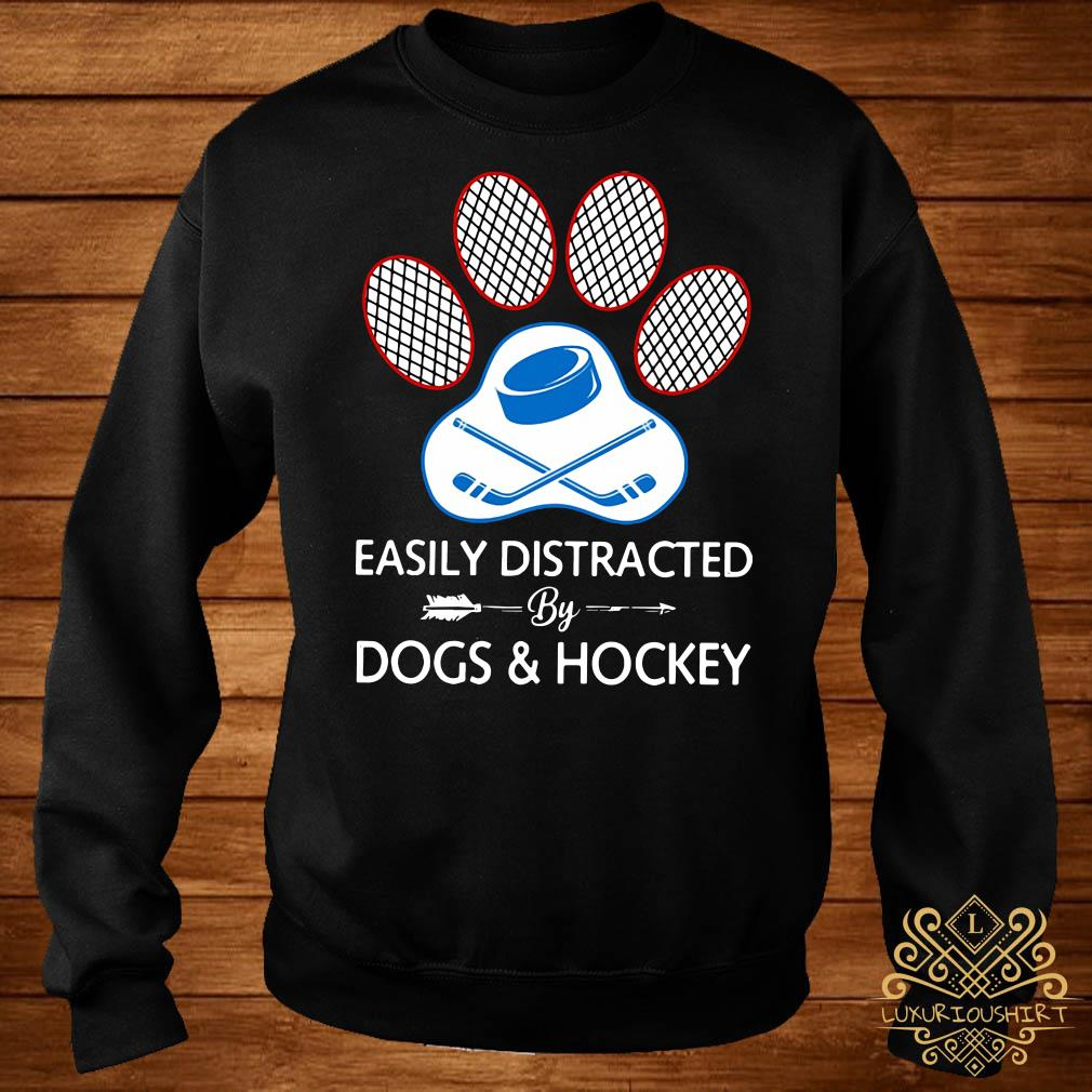 Paw easily distracted dogs and hockey sweater