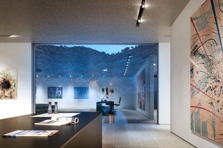 Ejerens kontor og galleri er placeret samme sted og har i stedet for havet udsigt til bjergene for at adskille arbejde og fornøjelse.