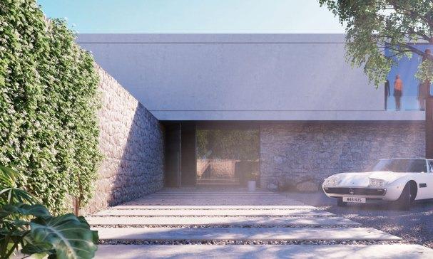 Indgangen til Superhuset er omgivet af vægge i lokale sten og fører dig ind til den minimalistiske gårdsplads. Garagen har plads til otte biler.
