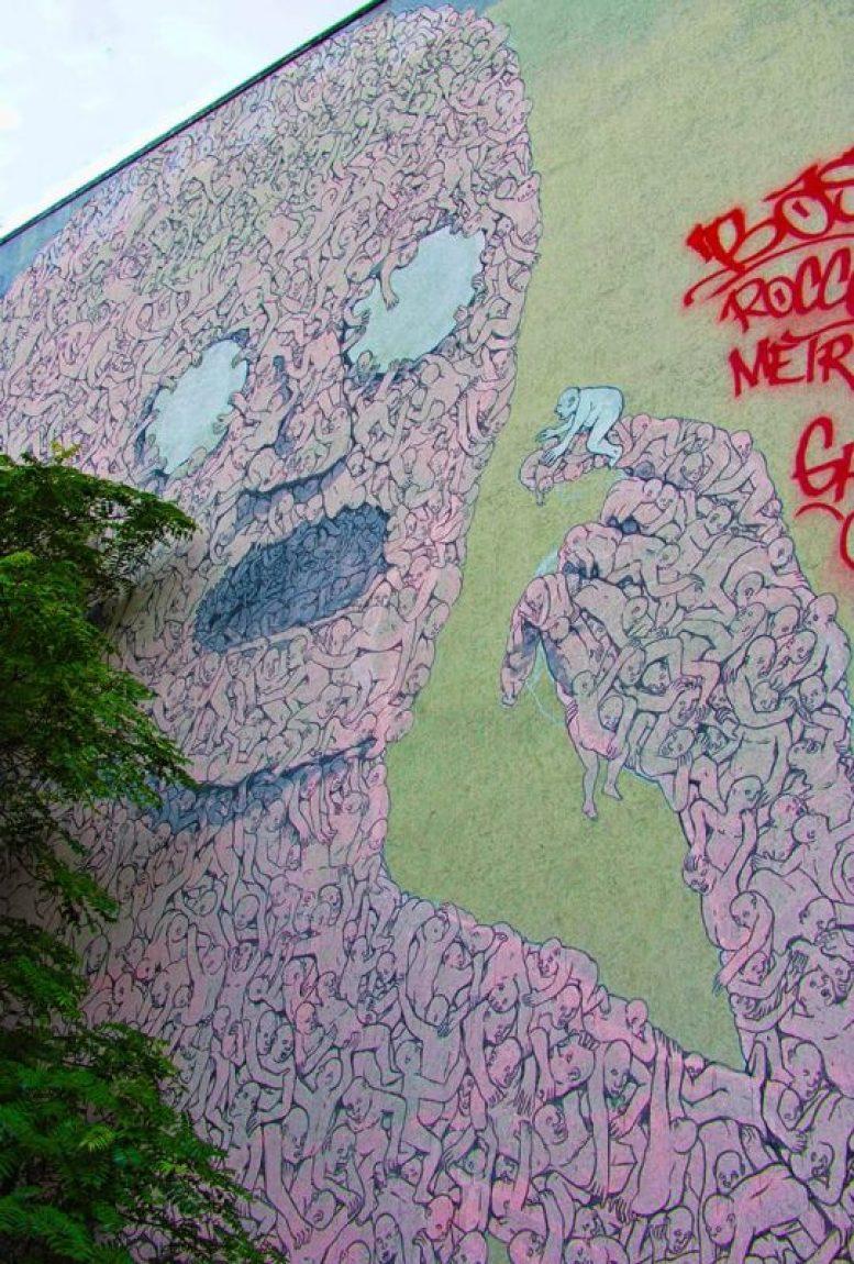 Pink Man by BLU - street art in Berlin, Germany