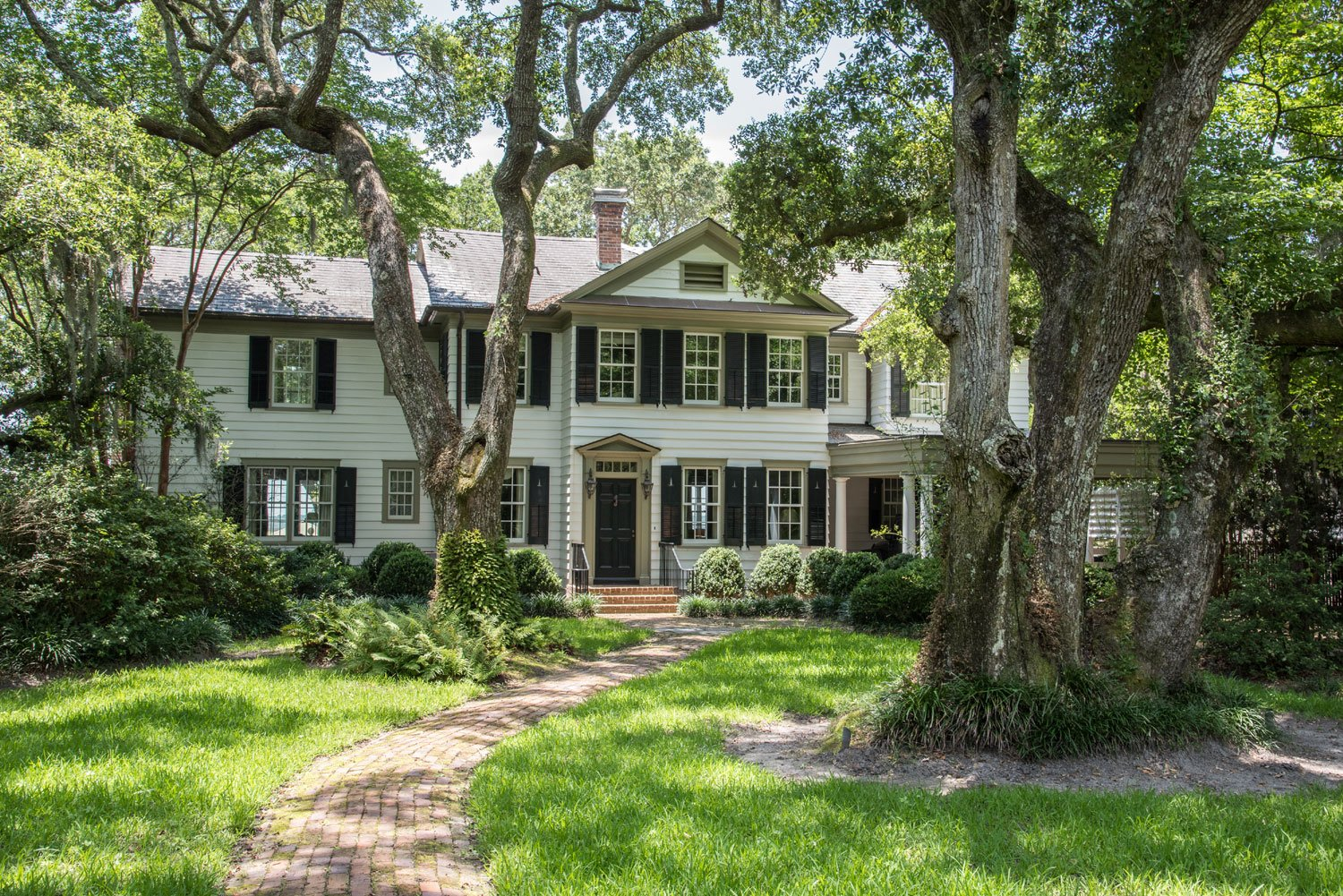 This Stono River home offers spectacular views from airy interiors with a formal living room, a vast galley kitchen, and a cedar-clad library, as well as its own private dock — and that river to dream on.