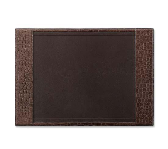"""Hermes desk blotter in black matte alligator leather. Measures 13.8"""" x 19.7"""" Ref. H046619CA89 $20,800.00"""