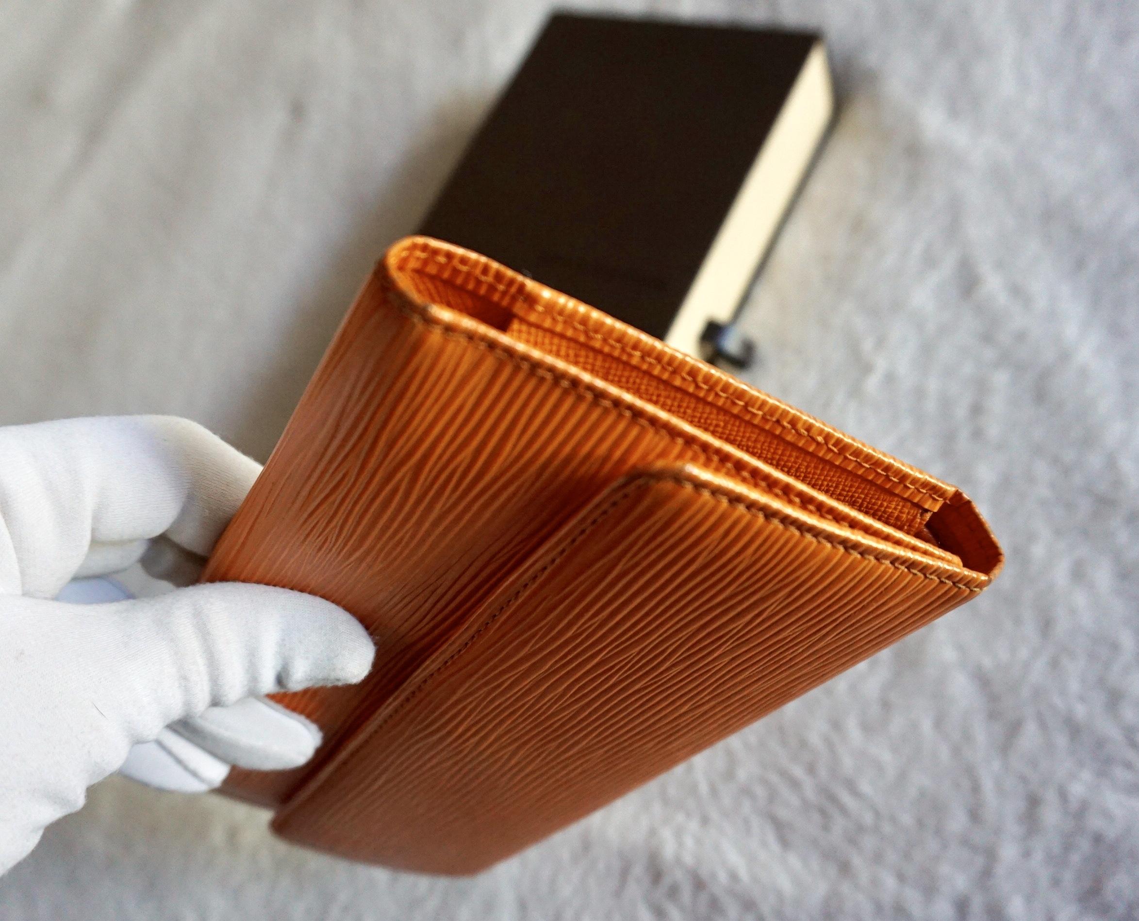 4098eb6feec4 Louis Vuitton Mandarin Epi Porte Tresor International Trifold Wallet · Home  ...