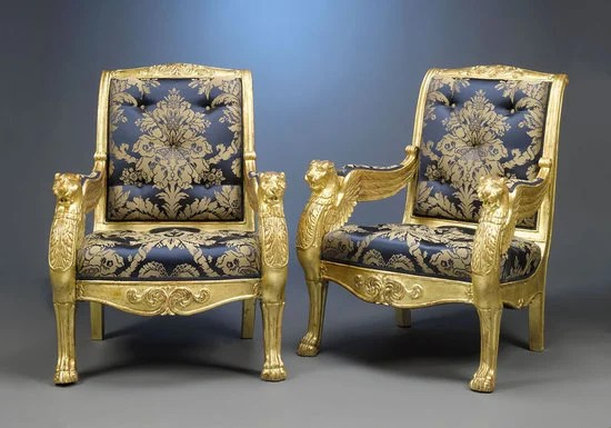 Gilded Antique French Armchairs Stand On Lion Paw Feet