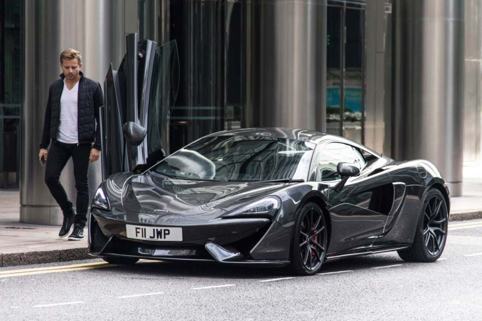 James Seen At Canary Wharf With His Mclaren 570s