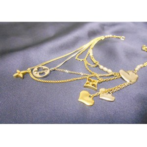 Louis Vuitton Bracelet With Charms in 18k