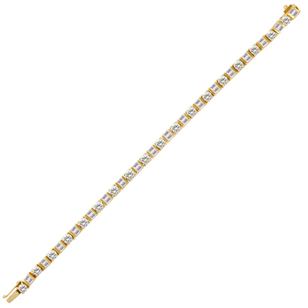 Round and Baguette diamond bracelet set in 18k yellow gold with app 7 cts