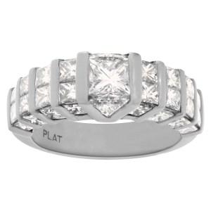 Platinum diamond band with channel set princess cut & trillion cut diamonds. 3.95cts