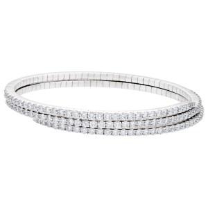 Flexible diamond coil bangle in 18k white gold. 7.32 carats in round diamonds.