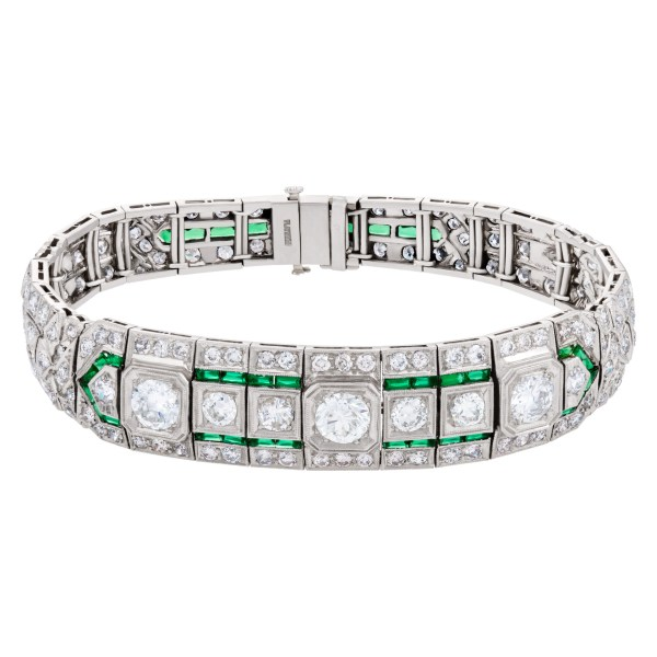 Vintage diamond platinum bracelet with french cut emerald accents approx. 8 carats in diamonds.
