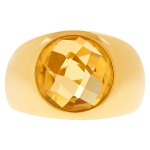 Shimmering faceted citrine ring in 18K yellow gold.