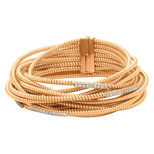 Spiral wrap bracelet with diamonds in 18k rose gold.