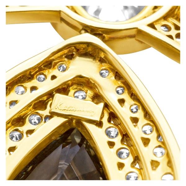 Kutchinsky diamond bow pin in 18k. GIA Certified. Total diamond weight 13.8 carats.