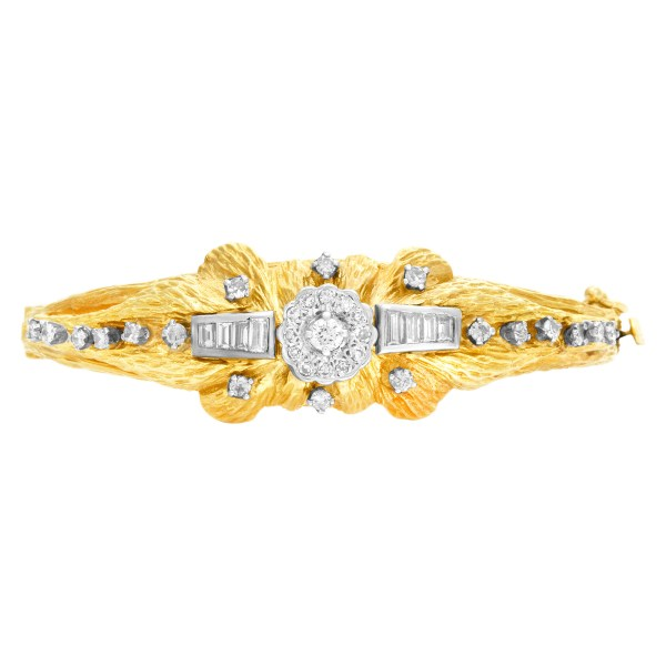 Diamond bangle with bark finish. 1.50 carats in round and baguette diamonds