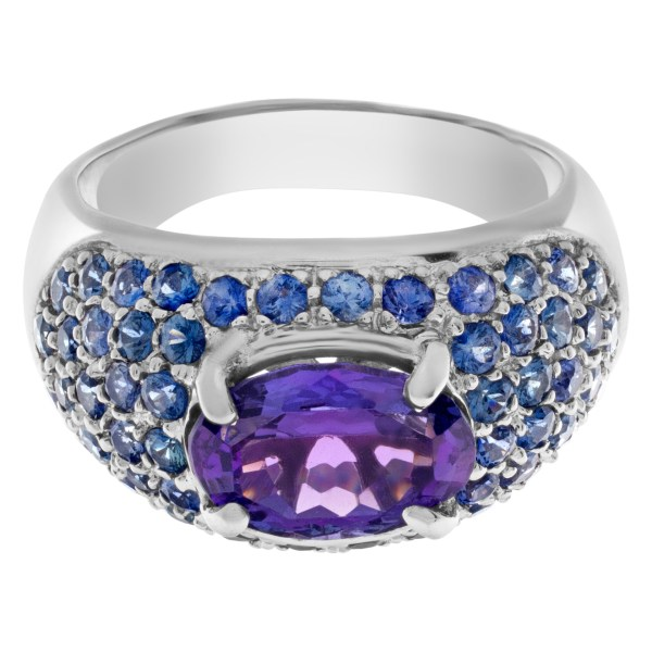 Bright oval ceneter (approximately 2 carats) tanzanite surrounded by sparkling pave tanzanite gems in 14k white gold