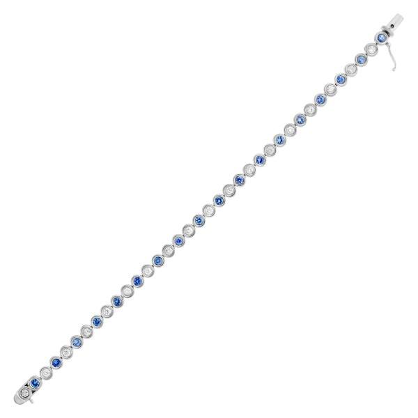 Bezel set blue sapphire and diamond tennis bracelet in 18k white gold
