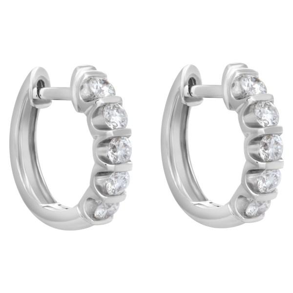 Diamond huggie earrings with over 1 carat in diamonds in 18k white gold