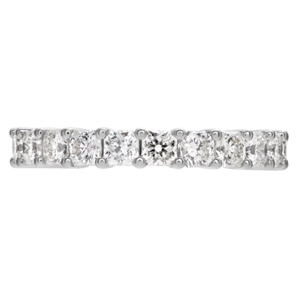 Diamond eternity band with 22 radiant cut diamonds, totaling 3.35 carats set in platinum.