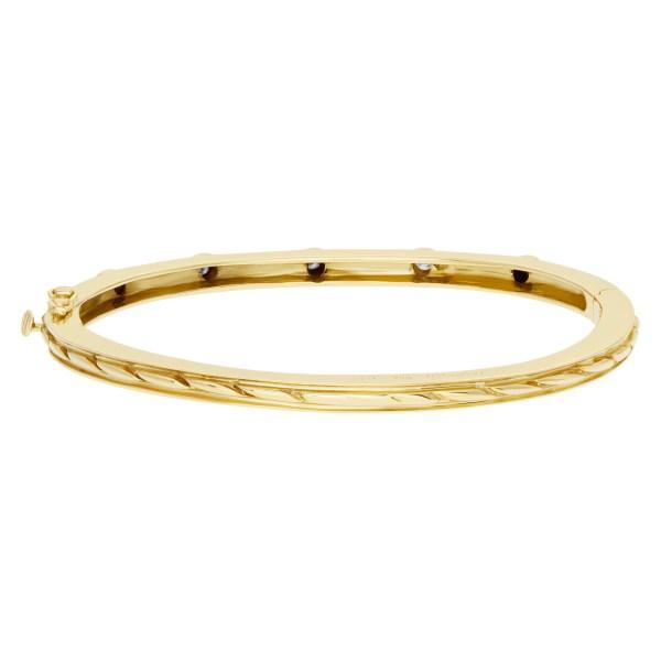 Bangle bracelet with 5 swirls in 14k yellow gold and diamonds