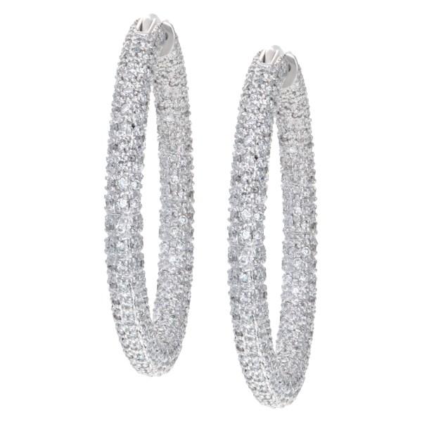Pave diamond hoop earrings mounted in 14k white gold