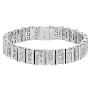 Channel set princess cut diamond bracelet in 18k white gold, over 16.20 carats in princess cut diamonds