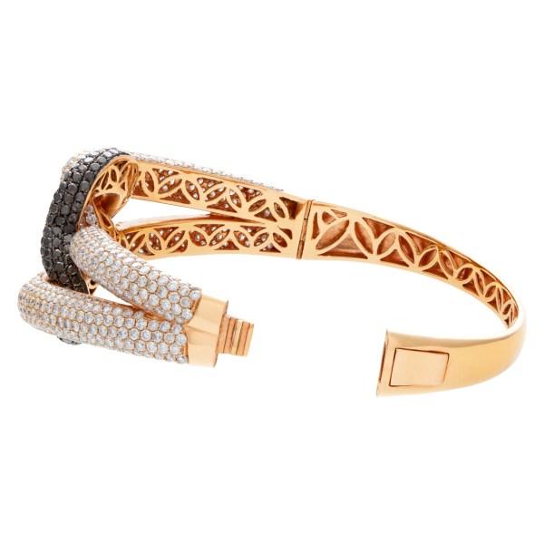Diamond bangle in 18k rose gold with 6 carats white diamonds & 2 carat black diamonds.