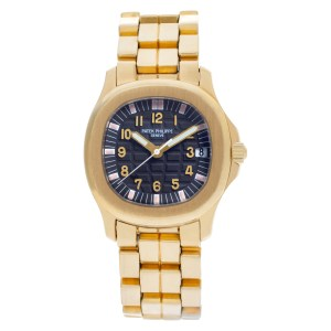Patek Philippe Aquanaut 5066/1J 18k yellow gold 34mm auto watch