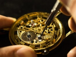 Professional restorer showing how to restore watch dial