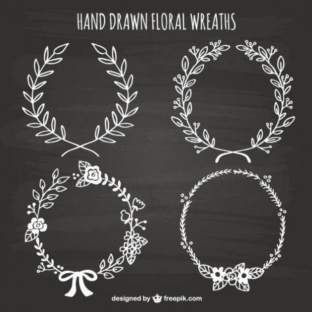hand-drawn-floral-wreaths-on-blackboard_23-2147521725.jpg