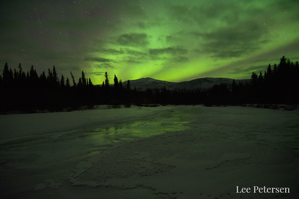 Northern lights reflecting off of overflow on the Chena River